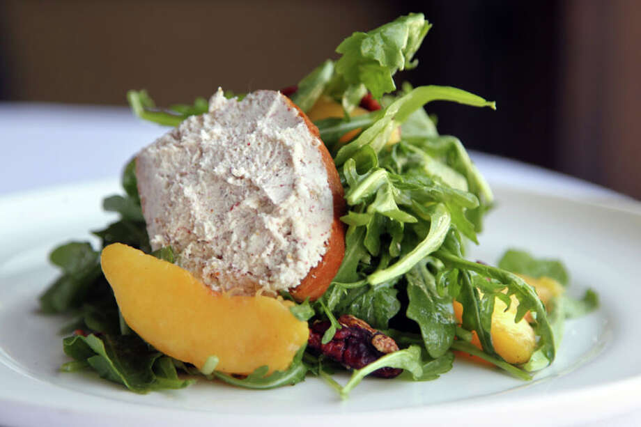 45. HavenCuisine: New AmericanDish:  arugula salad, peach vinaigrette, peaches, candied pecans, pink peppercorn and goat cheese toastEntree price range: $$$Where: 2502 Algerian WayPhone: 713-581-6101Website: havenhouston.comRead Alison Cook's review of Haven. Photo: Mayra Beltran, Houston Chronicle / Â 2013 Houston Chronicle