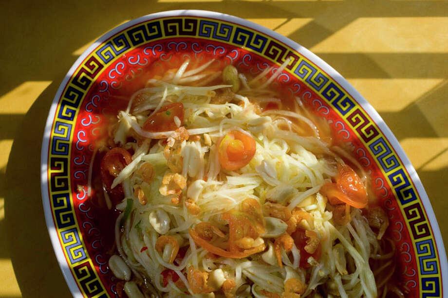 59. Asia MarketCuisine: ChineseDish: Som Tum (papaya salad)Entree price range: $Where: 1010 W. Cavalcade, Suite DPhone: 713-863-7074Website: asiamarkethouston.comRead Alison Cook's review of Asia Market. Photo: Johnny Hanson, Houston Chronicle / Houston Chronicle