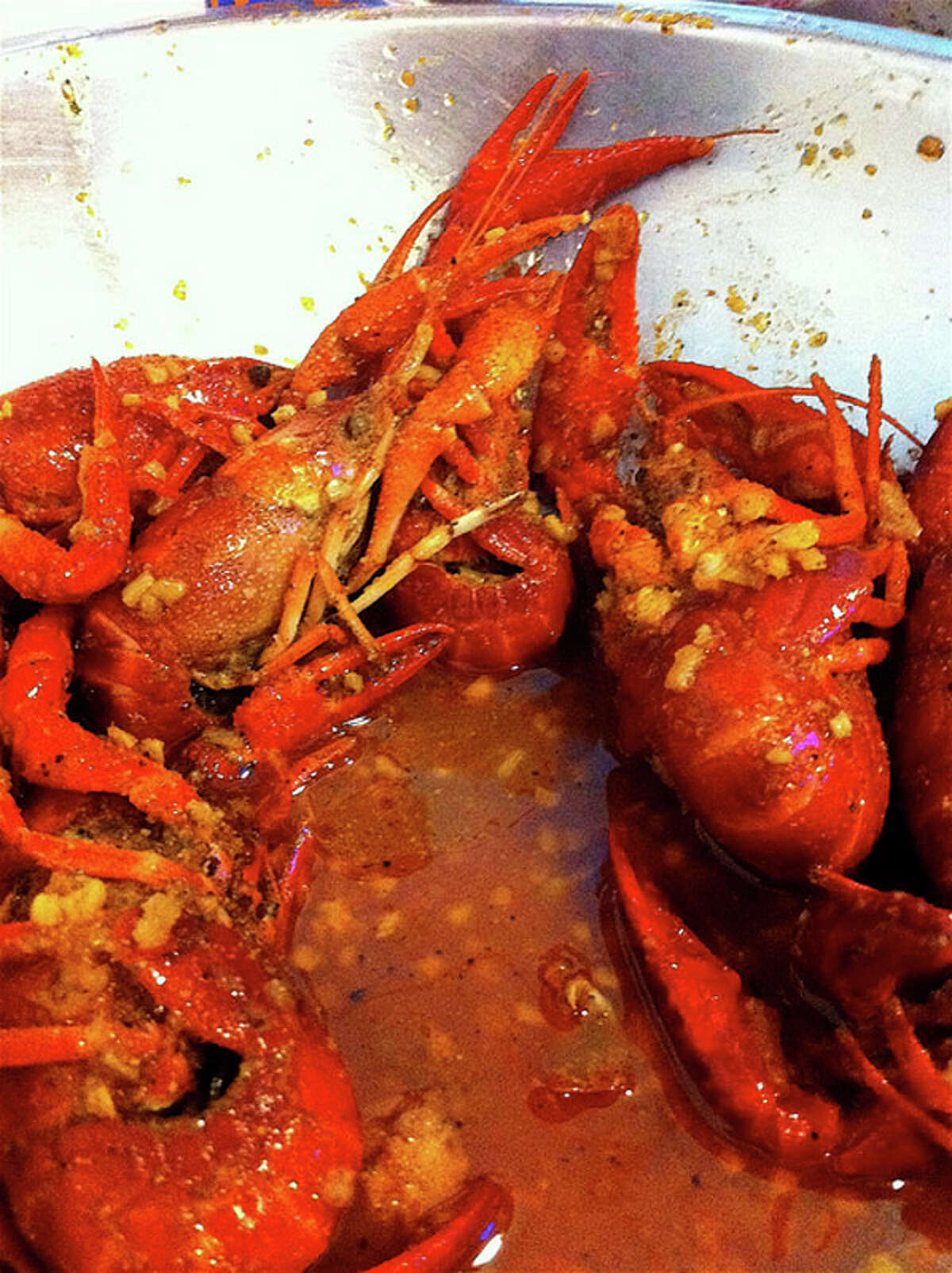 Crawfish boiled in garlicky, buttery, oniony, red-peppered broth