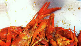 68. Crawfish & Noodles Cuisine: Vietnamese Dish: crawfish boiled in garlicky, buttery, oniony, red-peppered broth  Entree price range: $$ Where: 11360 Bellaire Phone: 281-988-8098 Website: crawfishandnoodle.com Find Alison Cook's review  here .