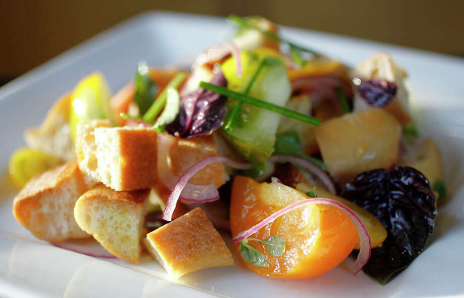 74. Plonk Cuisine: American Dish: Panzanella salad Entree price range: $$ Where: 1214 W. 43rd Phone: 713-290-1070 Website: plonkbistro.com Read Alison Cook's review of Plonk. Photo: Karen Warren, Houston Chronicle / © 2011 Houston Chronicle