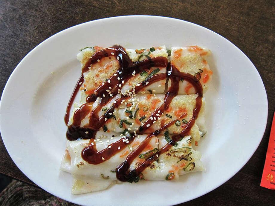 78. Yum Yum Cha CafeCuisine: ChineseDish: pan-fried shrimp rollEntree price range: $-$$Where: 2435 TimesPhone: 713-527-8455Website: yumyumchacafe.comRead Alison Cook's review of Yum Yum Cha Cafe. Photo: Alison Cook, Houston Chronicle