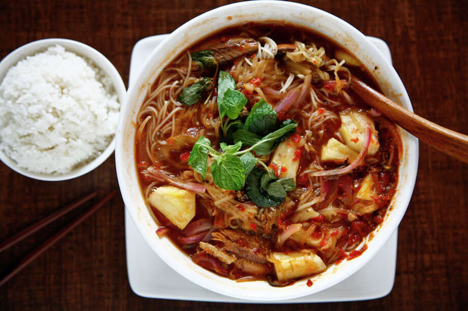 79. Banana Leaf Malaysian Cuisine: Malaysian Dish: Penang Assam Laksa noodle soup Entree price range: $-$$ Where: 9889 Bellaire Phone: 713-771-8118 Website: bananaleafhouston.com Read Alison Cook's review of Banana Leaf Malaysian. Photo: Michael Paulsen, Houston Chronicle / Houston Chronicle