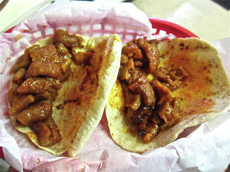 82. Taqueria LaredoCuisine: Mexican, Tex-MexDish: chicharrones en salsa rojo (red sauce) Entree price range: $Where: Northside Village, 113 Cavalcade, 713-695-0506; Washington Avenue, 915 Snover, 713-861-7279; Moody Park, 311 Patton, 713-695-0504Website: laredotaqueria4.comRead Alison Cook's review of Taqueria Laredo. Photo: Alison Cook