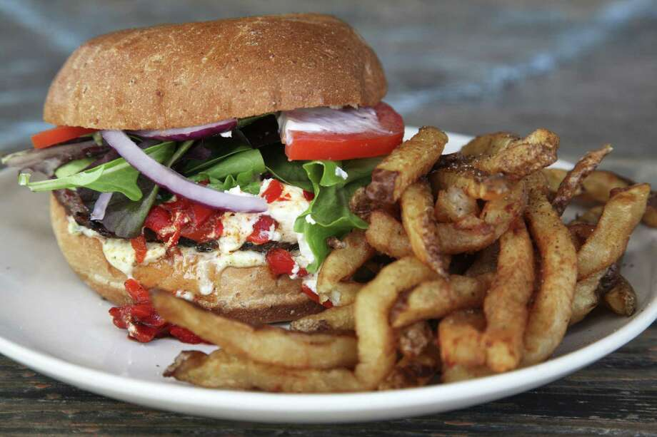 The Cove:606 W. Cypress St., 210-227-2683, www.thecove.us. This family-friendly restaurant offers a play area for the kids and good food for adults, including a Texas Burger that Texas Monthly named as one of the 50 best burgers in the state. Photo: Express-News File Photo