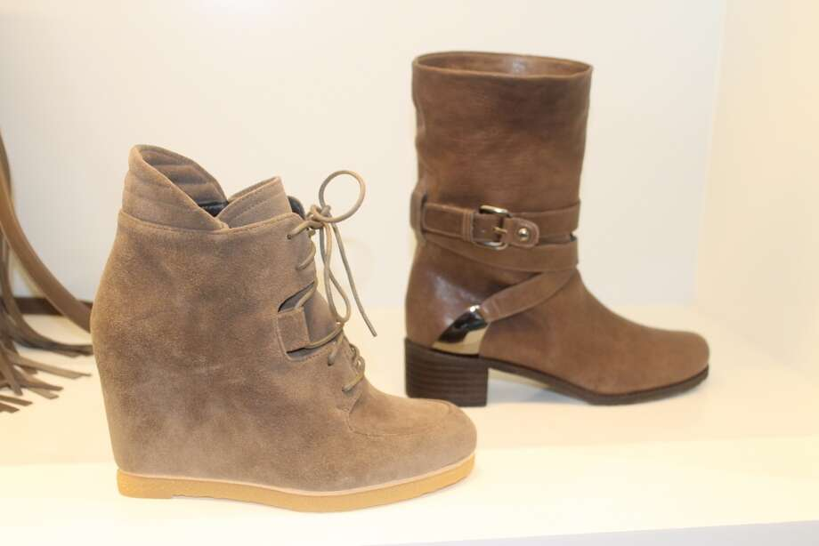 Wedges give you the leg-lengthening look you want and the comfort you need.  Wear these tan Stuart Weitzman beauties with leggings and a big, cozy sweater apres ski.  Another take on the motorcycle boot - this time in taupe - gives a little edge to jeans or sweater dresses.