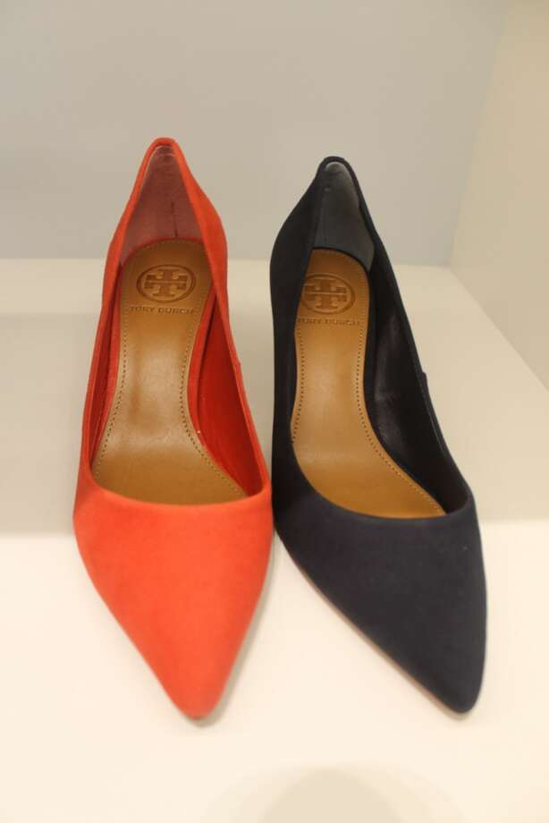 Yes, Dorothy, you can go home in red shoes!  Red and navy were huge color trends this summer that are transitioning to fall.  Tory Burch picks the perfect shades of each for her classic pumps.