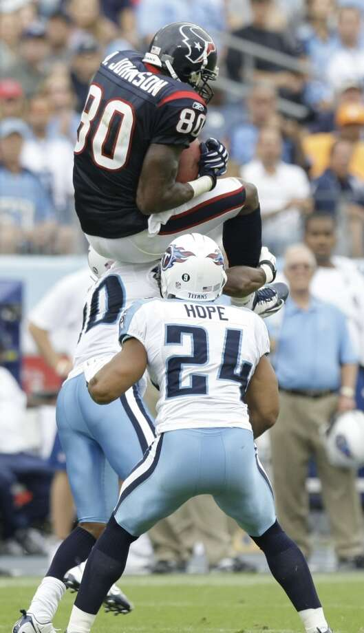 Texans 34, Titans 31 Sept. 20, 2009  Andre Johnson grabs 10 catches for 149 yards and 2 TDs to hold off big-play Chris Johnson (16 carries for 197 and 2 TDs - including 57 and 91-yard TD runs) and the Titans for the win. Kris Brown's fourth-quarter field goal with 2:55 left in the game breaks a 31-31 tie to seal the deal. Photo: Brett Coomer, Houston Chronicle