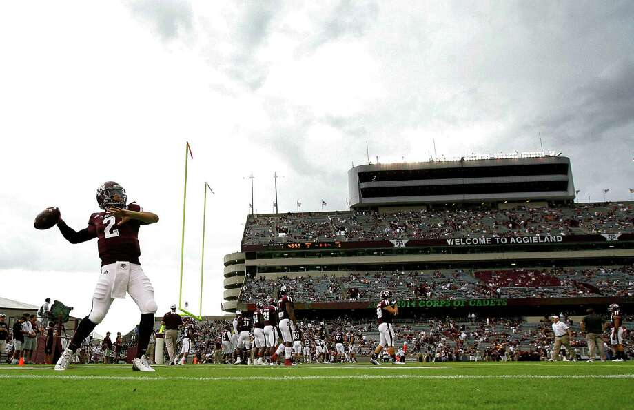 Texas A&M Aggies quarterback Johnny Manziel throws during warmups before the game against the Sam Houston State Bearkats at Kyle Field Saturday, Sept. 7, 2013, in College Station. Photo: Cody Duty, Houston Chronicle / © 2013 Houston Chronicle