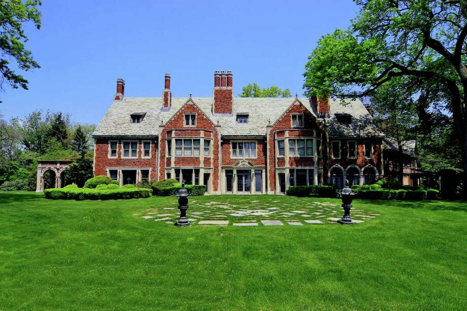 The Elizabethan Renaissance-style manor house with a Tudor Gothic Revival wing, situated with several other buildings on a 20-acre waterfront at the tip of Sasco Point, is on the market for $62 million. Photo: Contributed Photo / Fairfield Citizen contributed
