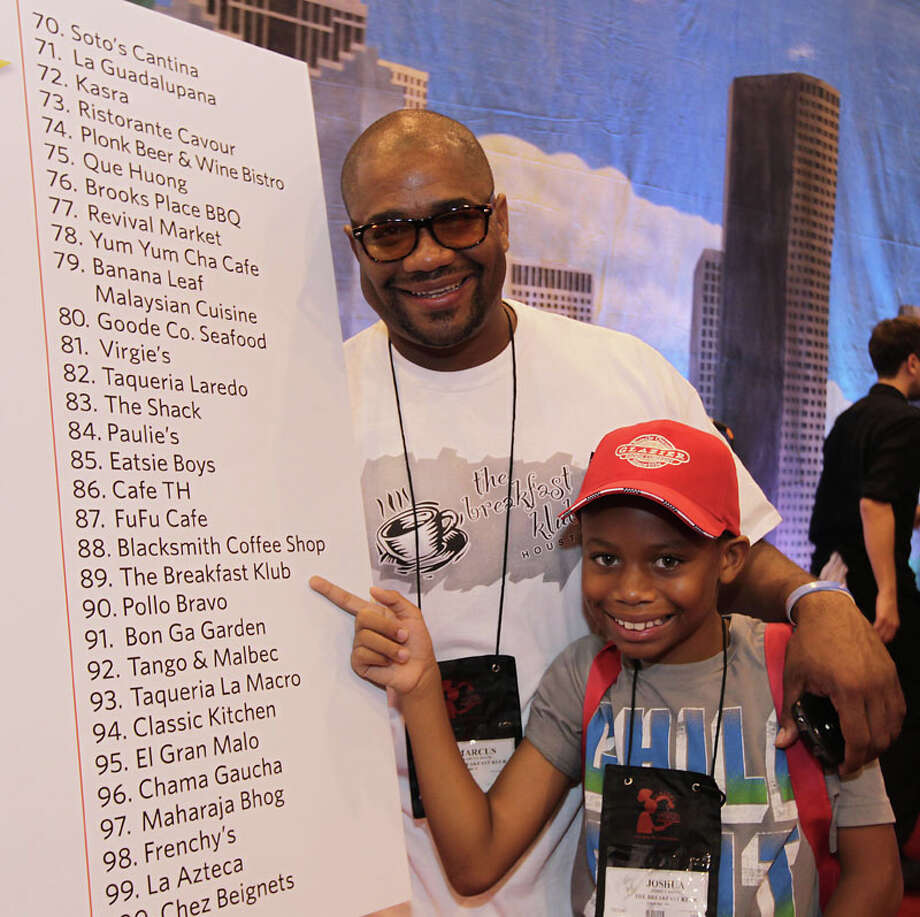 The Breakfast Klub's Marcus Davis and his son Joshua Davis during the Alison Cook's Top 100 Restaurants, 2013 edition winner announcements at Reliant Center Sept. 11, 2013. Photo: James Nielsen, Houston Chronicle / © 2013  Houston Chronicle