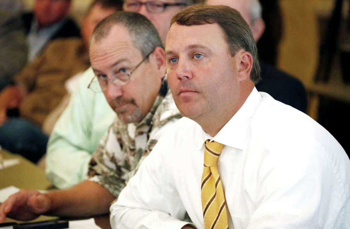 Republican Rep. Jason White, right, and Rep. Herb Frierson listen to experts on feral hogs discuss the growing problem of the animals that plague farmlands, natural habitat reserves, and now even urban areas at a Legislative Wild Hog Summit in Jackson, Miss., Monday, Sept. 9, 2013. (AP Photo/Rogelio V. Solis)