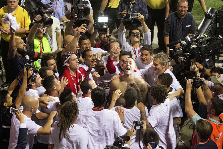 USMNT player Clint Dempsey (center with no shirt) and his teammates celebrate the USA Men's National Team clinching a birth in the 2014 FIFA World Cup after their World Cup Qualifier against Mexico at Columbus Crew Stadium in Columbus, OH on Sept. 10, 2013. Photo: Douglas Zimmerman, Courtesy Douglas Zimmerman/ ISI Photos / isiphotos.com