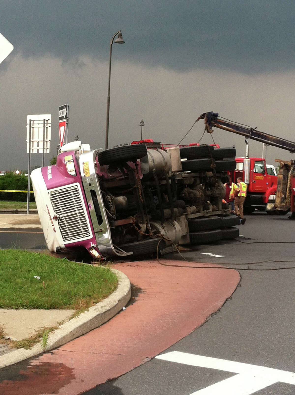 A truck carrying fuel rolled over on Route 9 Thursday afternoon, forcing authorities to close the road , order the evacuation of nearby homes and businesses and declare a state of emergency for a two-mile radius. (Scott Waldman / Times Union)