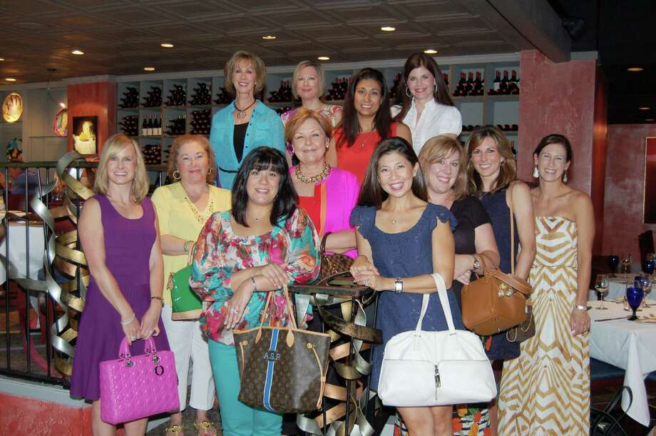 Open Your Purse for Change event chair Ally Seder, bottom row from left, with auction committee members Annabelle Carrillo, Ayesha Fayaz, Terry Larson, Katty Phan, Beth Griffith, Denise Lipar and Melissa Stanosheck.  Pictured top row, from left, are: Sher Photo: Courtesy Of The Montgomery County Women's Center