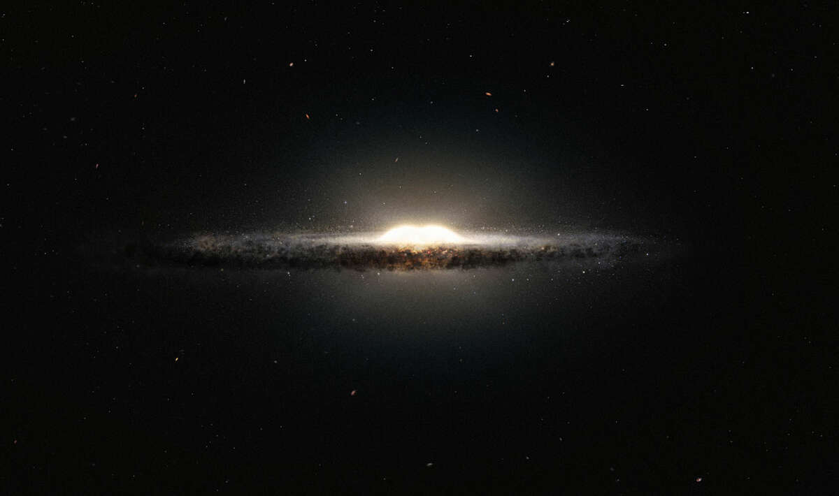 This artist's impression shows how the Milky Way galaxy would look seen from almost edge on and from a very different perspective than we get from the Earth. The central bulge shows up as a peanut shaped glowing ball of stars and the spiral arms and their associated dust clouds form a narrow band.