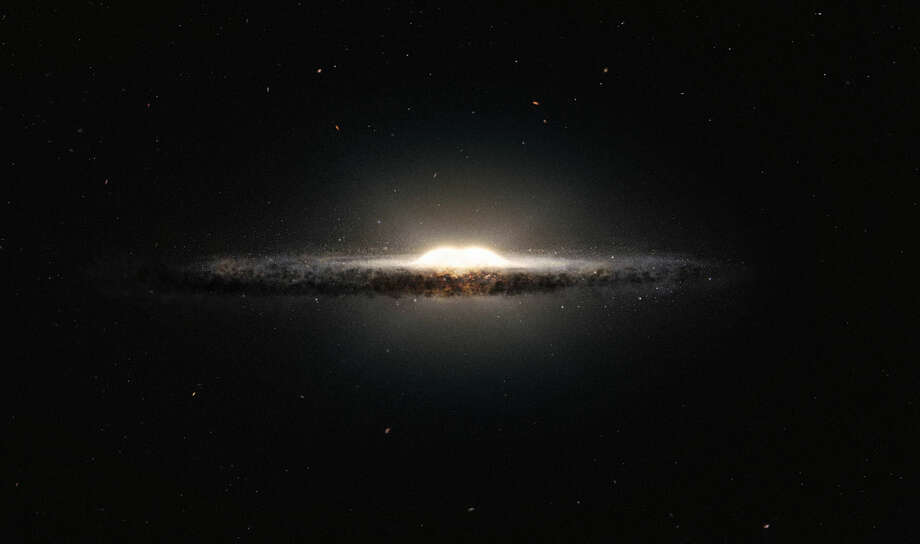 This artist's impression shows how the Milky Way galaxy would look seen from almost edge on and from a very different perspective than we get from the Earth. The central bulge shows up as a peanut shaped glowing ball of stars and the spiral arms and their associated dust clouds form a narrow band. Photo: ESO / European Southern Observatory