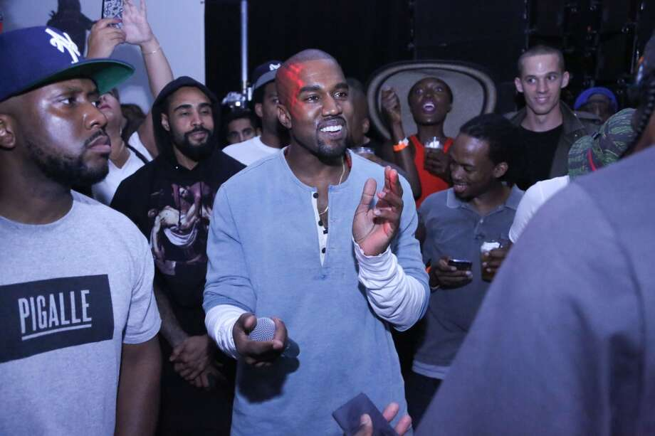 """Kanye West (C) attends the """"MNIMN"""" listening event at Industria Superstudio on September 11, 2013 in New York City.  (Photo by Johnny Nunez/WireImage) Photo: Johnny Nunez, WireImage"""