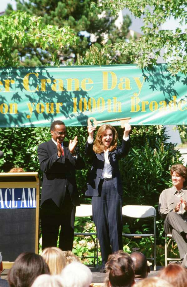 Peri Gilpin as Roz Doyle, with actual Seattle Mayor Norm Rice. Photo: Alice S. Hall, - / © NBC Universal, Inc.