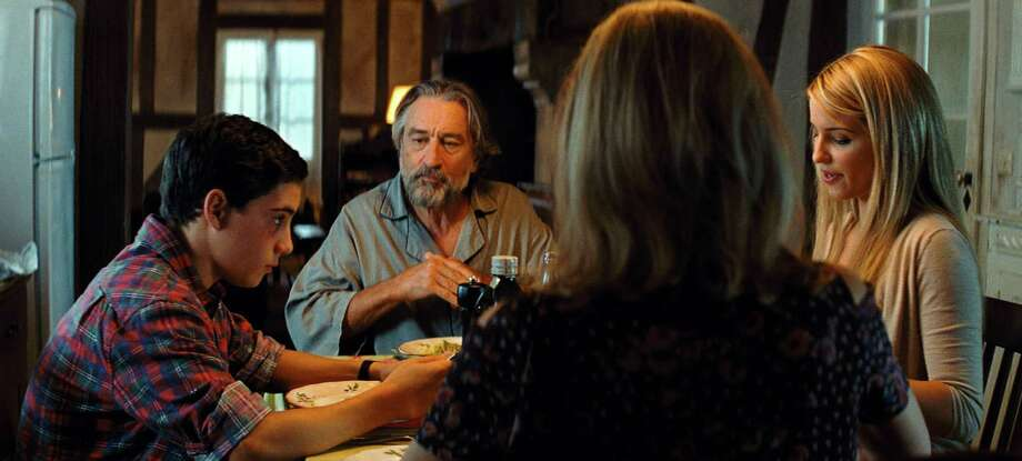 """John D'Leo, from left, Robert De Niro, Dianna Agron and Michelle Pfeiffer, not facing the camera, play a mob family hiding in France in """"The Family."""" Photo: HOEP / Relativity Media"""