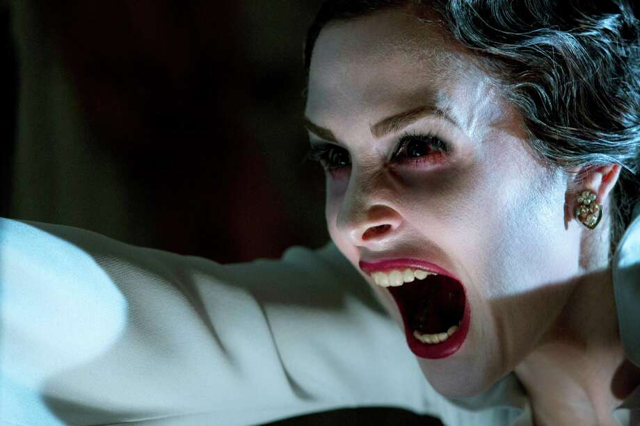 "This film image released by FilmDistrict shows Danielle Bisutti in a scene from ""Insidious: Chapter 2."" (AP Photo/FilmDistrict, Matt Kennedy) Photo: Matt Kennedy, HOEP / FilmDistrict"