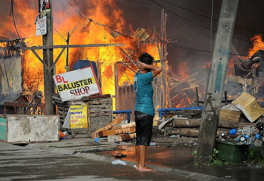 Houses burn during a firefight between government forces and Muslim rebels in Zamboanga city on the southern island of Mindanao, Philippines. Photo: Ted Aljibe, AFP/Getty Images
