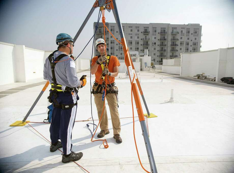 Matthew Nordt gets a lesson before rappelling down 101 Park Place at Harbor Point in Stamford, Conn., during Over the Edge, a fundraiser for Special Olympics Connecticut. Photo: Lindsay Perry / Stamford Advocate