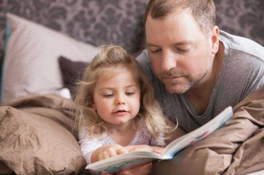 According to the national campaign Read Aloud 15 Minutes, reading aloud to a child every day for 15 minutes from birth will change the face of education in this country. (Cultura / Matelly / Getty)