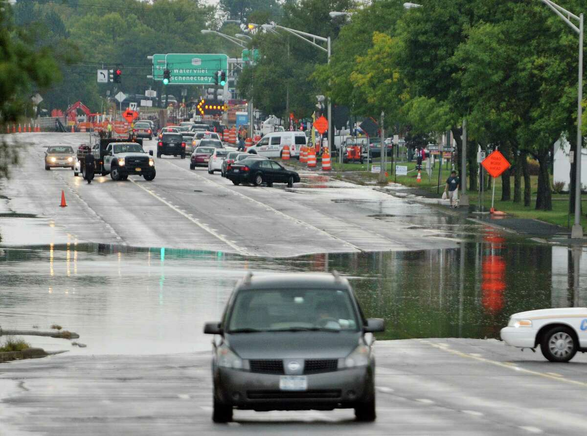 A driver turns around and heads away from a flooded section of Route 9 just north of Watervliet Shaker Road Thursday afternoon, Sept. 12, 2013, in Latham, N.Y. (Paul Buckowski / Times Union)