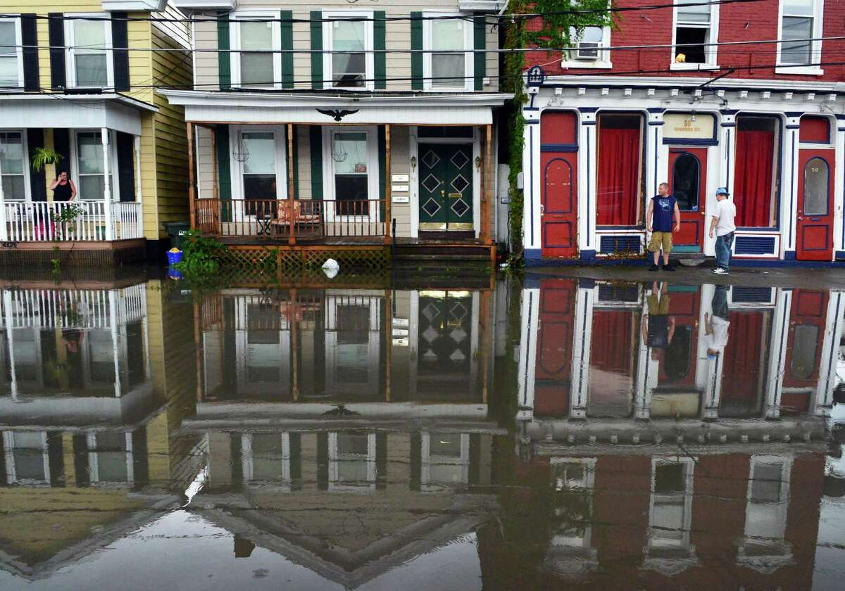 Floodwaters encroched on Oneida Street homes Thursday afternoon, Sept. 12, 2013, in Cohoes, N.Y. (John Carl D'Annibale / Times Union)
