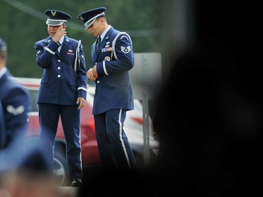 Members of the Air National Guard tear up outside the wake of soldier TJ Lobraico at the O'Neill Center in Danbury, Conn. on Thursday, Sept. 12, 2013.  Staff Sgt. Lobraico, a member of the Air National Guard 105th Security Forces Squadron, was killed last Thursday after his unit was attacked near Bagram Airfield.  A public service will be held Friday at 11 a.m. at the O'Neill Center, and will be buried with full military honors following the funeral. Photo: Tyler Sizemore / The News-Times