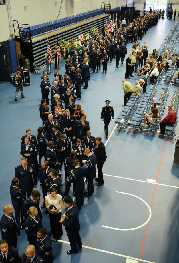 Members of the Air National Guard and Stamford Police Department wait in line for the wake of soldier TJ Lobraico at the O'Neill Center in Danbury, Conn. on Thursday, Sept. 12, 2013.  Staff Sgt. Lobraico, a member of the Air National Guard 105th Security Forces Squadron, was killed last Thursday after his unit was attacked near Bagram Airfield.  A public service will be held Friday at 11 a.m. at the O'Neill Center, and will be buried with full military honors following the funeral. Photo: Tyler Sizemore / The News-Times