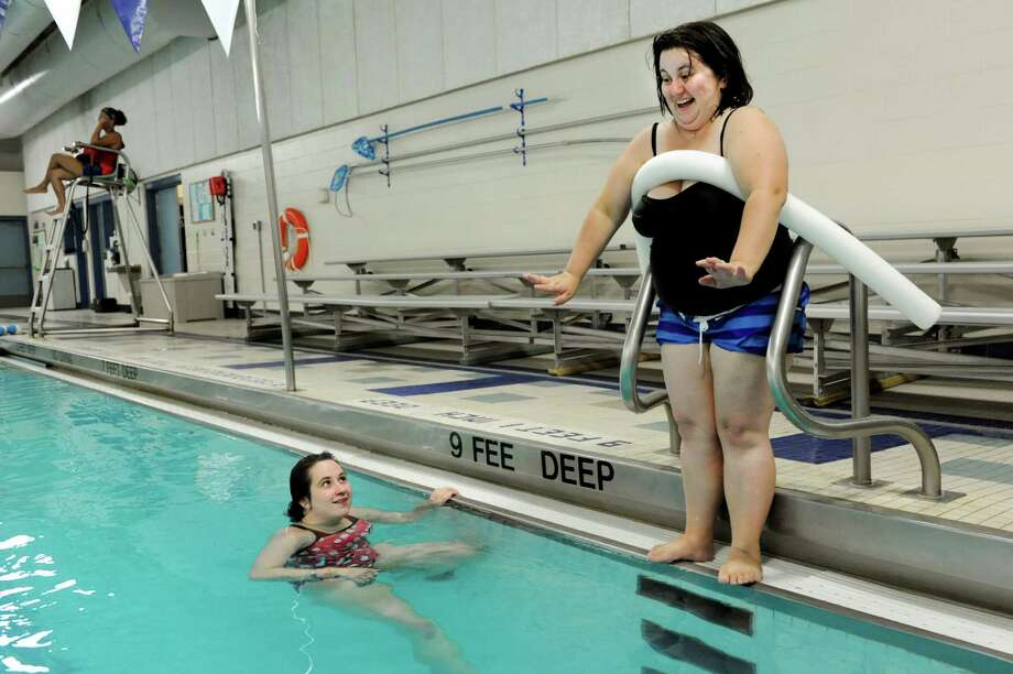 Shannon Pratt of Rensselaer, right, gets ready to jump in the deep end as swim instructor Molly Moran speaks words of encouragement on Thursday, Aug. 15, 2013, at the East Greenbush YMCA in East Greenbush , N.Y. (Cindy Schultz / Times Union) Photo: Cindy Schultz / 00023505A
