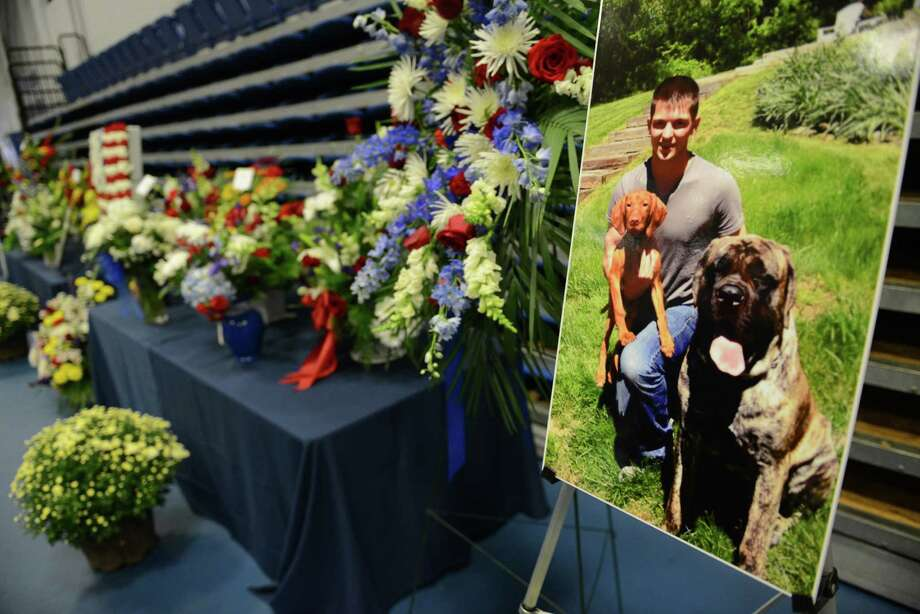 A photo of soldier TJ Lobraico displayed during his wake at the O'Neill Center in Danbury, Conn. on Thursday, Sept. 12, 2013.  Staff Sgt. Lobraico, a member of the Air National Guard 105th Security Forces Squadron, was killed last Thursday after his unit was attacked near Bagram Airfield.  A public service will be held Friday at 11 a.m. at the O'Neill Center, and will be buried with full military honors following the funeral. Photo: Tyler Sizemore / The News-Times