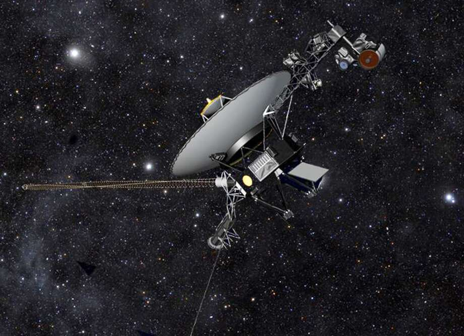 This artist rendering released by NASA shows NASA's Voyager 1 spacecraft barreling through space. The space agency announced Thursday, Sept. 12, 2013 that Voyager 1 has become the first spacecraft to enter interstellar space, or the space between stars, more than three decades after launching from Earth. (AP Photo/NASA) Photo: HOPD, Associated Press
