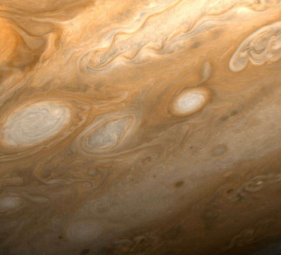his photo of Jupiter was taken by Voyager 1 on March 1, 1979, from a distance of 2.7 million miles (4.3 million kilometers). The region shown is just to the southeast of the Great Red Spot. A small section of the spot can be seen at upper left. One of the 40-year-old white ovals in Jupiter's atmosphere can also be seen at middle left, as well as a wealth of other atmospheric features, including the flow lines in and around the ovals. The smallest details that can be seen in this photo are about 45 miles (80 kilometers) across. (Photo by NASA) Photo: NASA
