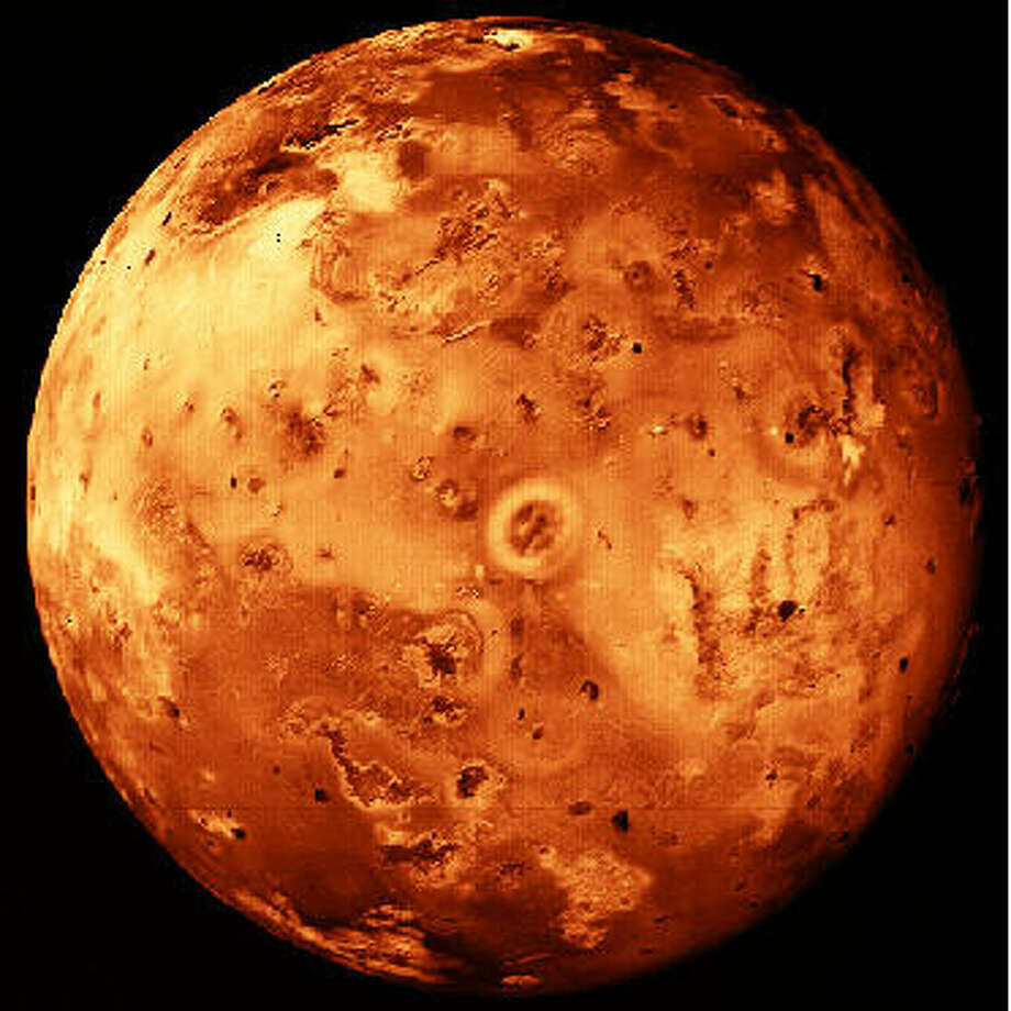 "In 1610, Galileo turned his telescope to the heavens and discovered that the planet Jupiter had four bright moons. The innermost of these Galilean moons, Io, turned out to be one of the most exotic objects in the solar system. About the size of the earth's moon, Io is covered with volcanoes, many of which are currently active. The material expelled in the volcanic eruptions may contain compounds of Sulfur which take on a variety of colors and could account for its mottled, ""pizza-like"" appearance. (Photo by NASA) Photo: NASA"