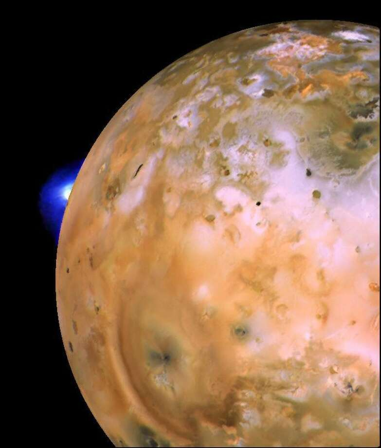 This image provided by NASA shows an image taken by the Voyager 1 spacecraft showing a volcanic plume on the Jupiter moon Io. Launched in 1977, the twin spacecraft are exploring the edge of the solar system. Voyager 1 is poised to cross into interstellar space. (AP Photo/NASA) Photo: Associated Press