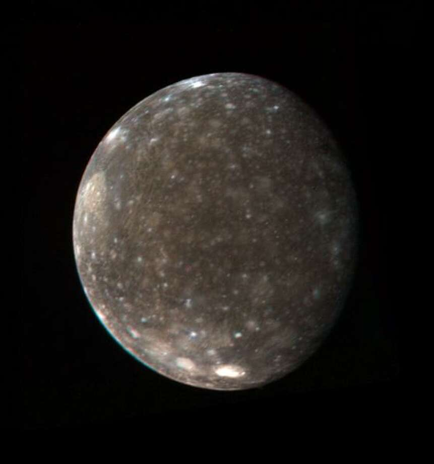This color photo of Jupiter's satellite Callisto was made from three black-and-white images taken March 5 from a distance of 746,000 miles (1.2 million kilometers). It shows the entire hemisphere of Callisto that was photographed at high resolution by Voyager 1 during the close encounter with the satellite on March 6. Visible near the upper left limb is the large basin-like structure discovered by Voyager 1. The central region of the basin is much brighter than the average surface of the satellite. Near the south polar region are two bright areas associated with smaller basin-like structures. These bright areas are believed to contain more clean ice than the rest of Callisto's generally 'dirty-ice' surface. (Photo by NASA) Photo: NASA