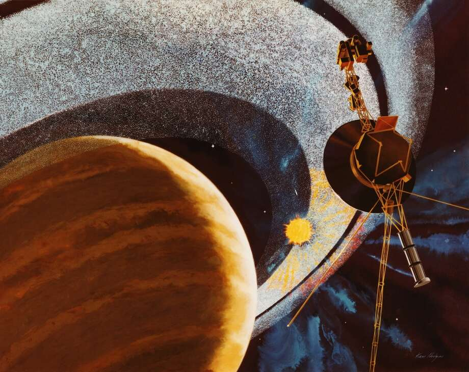 FILE - SEPTEMBER 12: Scientists at NASA have declared Voyager 1 to become the first human-made object to leave the solar system and enter interstellar space. Launched in 1977, the Voyager probe was originally designed as a four-year mission to explore Saturn, and today is estimated to be 12 billion miles from Earth.  An artist's impression of NASA's Voyager 1 space probe passing behind the rings of Saturn, using cameras and radio equipment to measure how sunlight is affected as it shines between the ring particles. The image was produced in 1977, before the craft was launched, and depicts events due to take place in 1980. (Photo by NASA/Hulton Archive/Getty Images) Photo: NASA, Getty Images