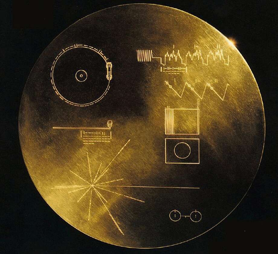 "This is a undated handout provided by NASA shows the Voyager Golden Record. NASA's twin Voyager spacecraft launched in August and September 1977. Aboard each spacecraft was a Golden Record, a collection of sites, sounds and greetings from Earth. Each identical Golden Record contained, 117 pictures explaining Earth, greetings in 54 different human languages and greetings from humpback whales. Also, a selection of sounds from Earth.  The best-selling pop album on planet Earth and a disc sent hurtling into deep space are among recordings the Library of Congress will preserve for their cultural significance. Twenty-five selections were added to the National Recording Registry on Wednesday, part of the library's attempt to save America's aural history by archiving recordings deemed ""culturally, historically or aesthetically significant."" (AP Photo/NASA) Photo: Anonymous, AP"