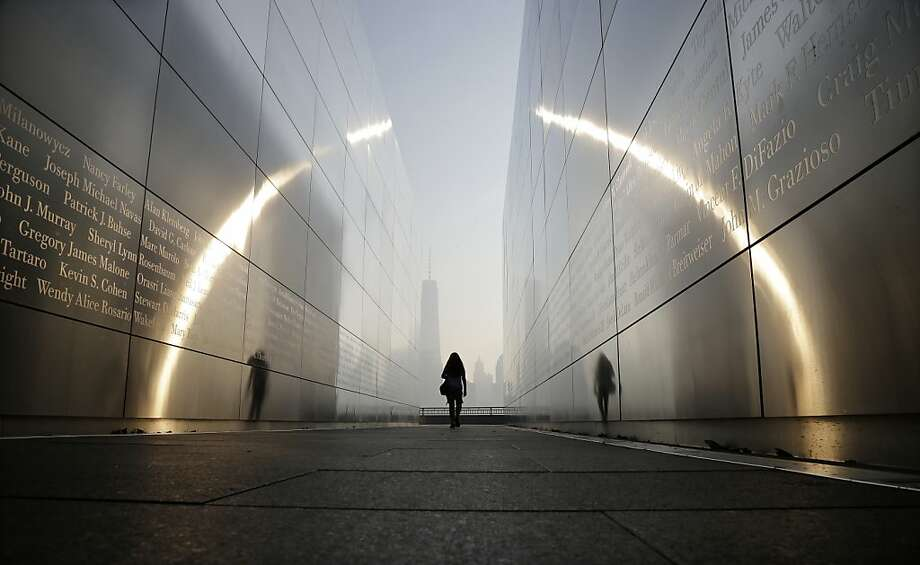 "Somber space: Visitors walk through the ""Empty Sky"" memorial to New Jersey's victims of the Sept. 11 terrorist attacks in 