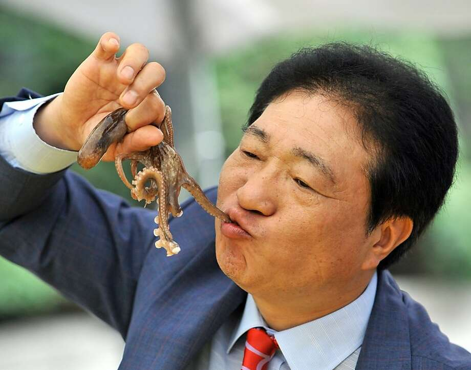 Eat like a Klingon:A South Korean man chews on a live octopus during an event promoting a local food festival in Seoul. Photo: Jung Yeon-Je, AFP/Getty Images
