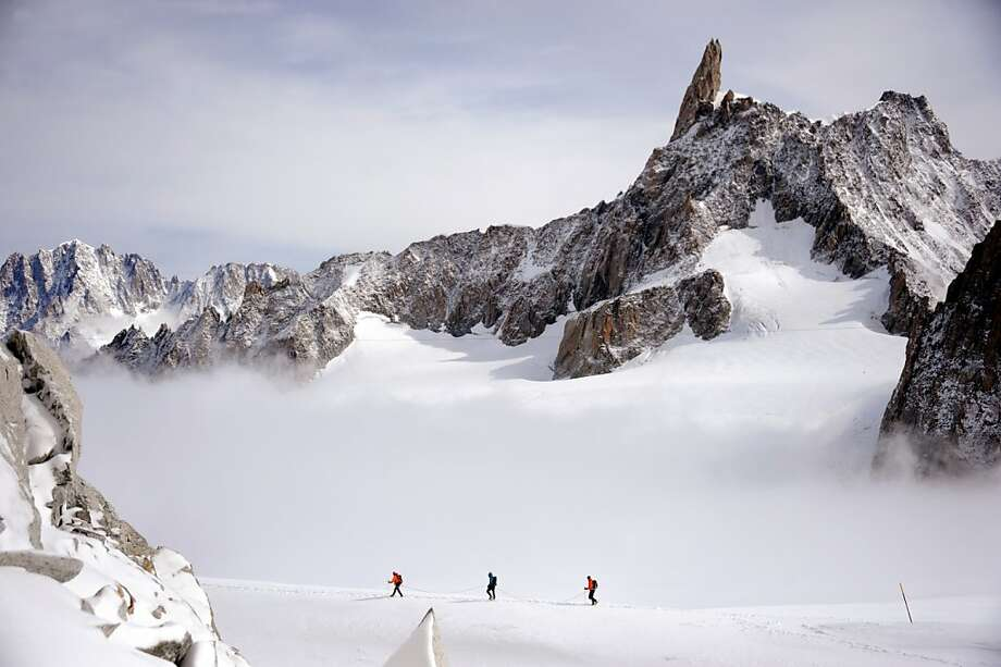 Dental appointment:Roped climbers trek across a glacier near the Dent du Géant (Giant's tooth) in the Mont Blanc massif in France and 