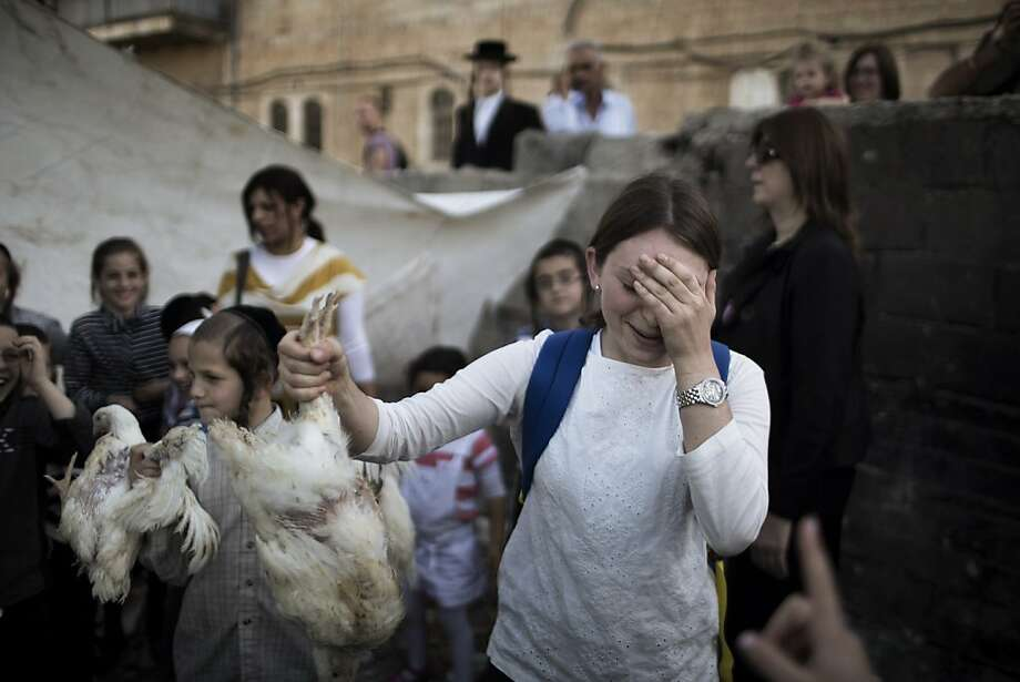 I can't believe I'm doing this:A Jewish girl prepares to swing a chicken over her head in order to pass her 