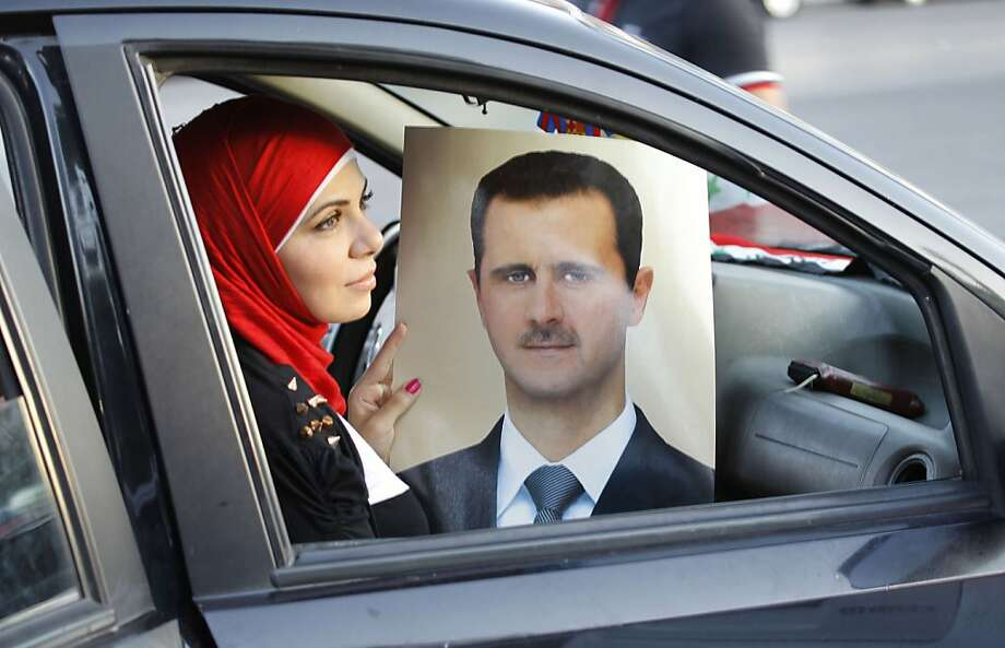 Tired of Syria's desert rays turning your sedan into an oven? Get the new Bashar al-Assad Windshield Sun 