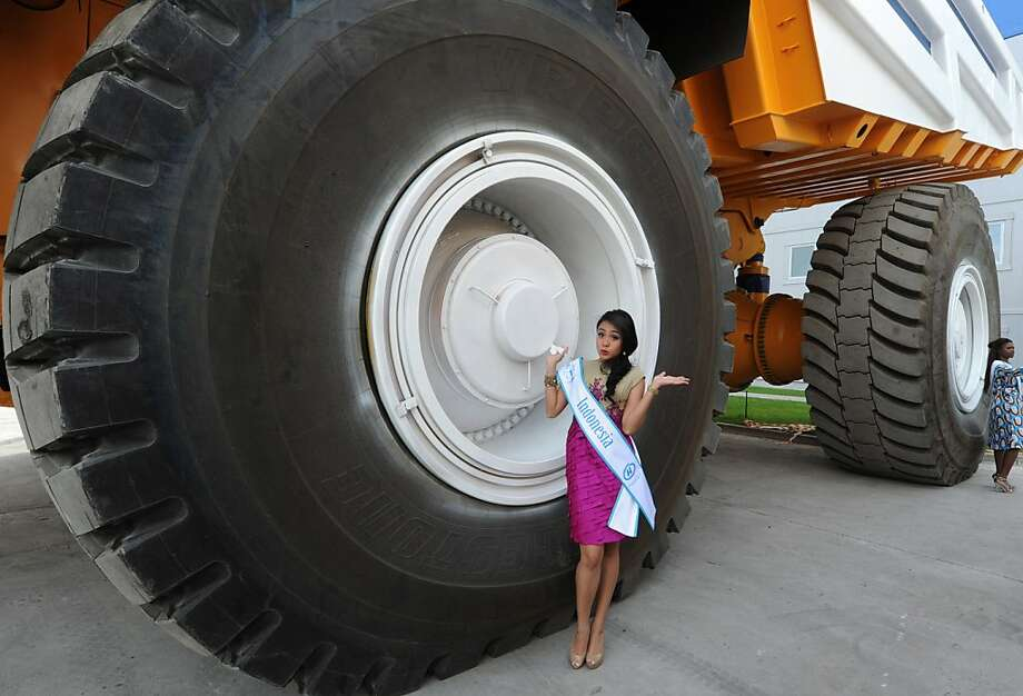 Honey, I shrunk Miss Indonesia:Actually, Cok Krisnanda just appears to be Barbie™ size because she's standing next to an enormous, 360-ton-payload mining dump truck at the BelAZ plant in Zhodino, Belarus. Minsk hosted the Miss Supranational 2013 beauty contest last weekend. Photo: Viktor Drachev, AFP/Getty Images