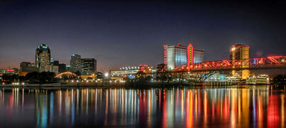 Downtown Shreveport, La., as seen from the Bossier City bank of the Red River, features the neon-adorned Long-Allen Bridge, named in part for controversial politician Huey P. Long. Photo: Courtesy Shreveport-Bossier Convention And Tourist Bureau