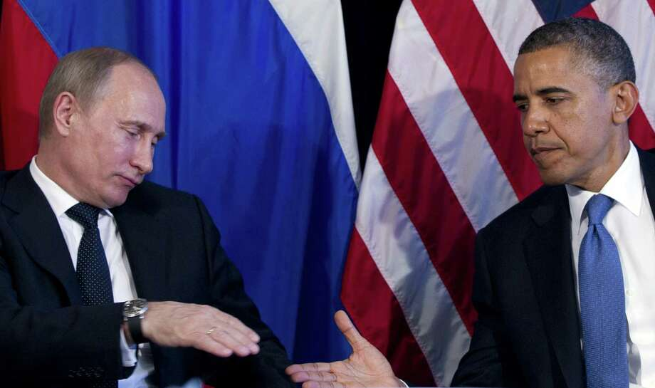President Barack Obama and Russia's President Vladimir Putin during the 2012 G20 Summit in Mexico. Obama has stumbled into a face-saving diplomatic dance with Putin over Syria's chemical weapons. Photo: File Photo, San Antonio Express-News