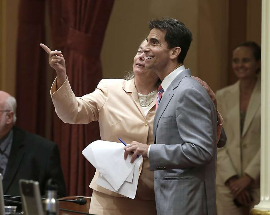 State Sens. Fran Pavley and Mark Leno watch the vote on their bill to place new limits on fracking. Photo: Rich Pedroncelli, Associated Press